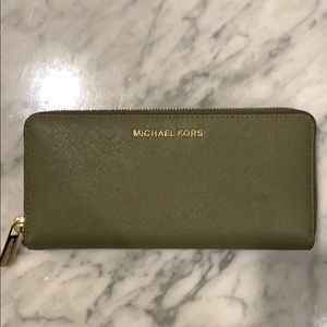 Green Michael Kors wallet with gold detail